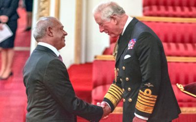 Park Garage Group director Balraj Tandon receives his MBE from Prince Charles